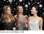 Купить «happy young women dancing at night club disco», фото № 23922125, снято 21 ноября 2015 г. (c) Syda Productions / Фотобанк Лори
