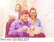 Купить «team with tablet pc computer sitting on staircase», фото № 23922221, снято 1 февраля 2014 г. (c) Syda Productions / Фотобанк Лори