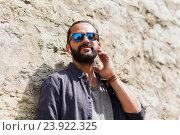 Купить «happy man with earphones listening to music», фото № 23922325, снято 2 июня 2016 г. (c) Syda Productions / Фотобанк Лори