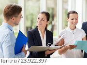 Купить «business team with folders meeting at office», фото № 23922397, снято 3 июля 2016 г. (c) Syda Productions / Фотобанк Лори