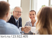 Купить «senior businessman making handshake at office», фото № 23922405, снято 3 июля 2016 г. (c) Syda Productions / Фотобанк Лори