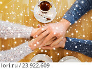 Купить «close up of couple holding hands at restaurant», фото № 23922609, снято 23 января 2016 г. (c) Syda Productions / Фотобанк Лори