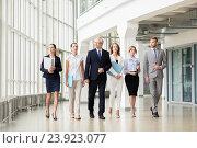 Купить «business people walking along office building», фото № 23923077, снято 3 июля 2016 г. (c) Syda Productions / Фотобанк Лори