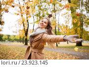 Купить «happy woman having fun with leaves in autumn park», фото № 23923145, снято 6 октября 2016 г. (c) Syda Productions / Фотобанк Лори