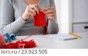 Купить «woman knitting with needles and red yarn», видеоролик № 23923505, снято 22 октября 2016 г. (c) Syda Productions / Фотобанк Лори