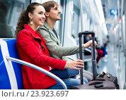 Portrait of happy positive metro passengers sitting in car seats. Стоковое фото, фотограф Яков Филимонов / Фотобанк Лори