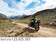 Купить «Motorbike tourism. Traveller at motorcycle in mountains», фото № 23925393, снято 5 июля 2012 г. (c) Дмитрий Калиновский / Фотобанк Лори