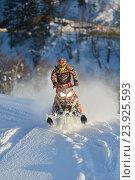Купить «Athlete on a snowmobile moving in the mountains», фото № 23925593, снято 23 января 2015 г. (c) Алексей Суворов / Фотобанк Лори
