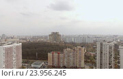Купить «Aerial view of one of the districts of Moscow, cloudy and foggy weather. Urban cityscape from quadrocopter», видеоролик № 23956245, снято 26 августа 2016 г. (c) Данил Руденко / Фотобанк Лори