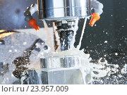 Купить «Milling process. precision CNC machining by vertical mill with coolant», фото № 23957009, снято 26 мая 2016 г. (c) Дмитрий Калиновский / Фотобанк Лори