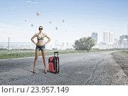 Купить «Hitch hiker woman on road . Mixed media», фото № 23957149, снято 26 июня 2013 г. (c) Sergey Nivens / Фотобанк Лори