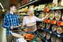 Spouses choosing pizza in store, фото № 23957657, снято 27 октября 2016 г. (c) Яков Филимонов / Фотобанк Лори