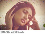 Купить «Composite image of pretty female dj listening music on headphone», фото № 23969929, снято 19 марта 2019 г. (c) Wavebreak Media / Фотобанк Лори