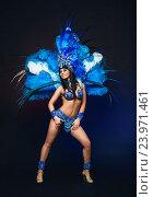 Купить «Симпатичная молодая девушка в ярком синем карнавальном костюме на темном фоне», фото № 23971461, снято 24 января 2015 г. (c) Евгений Захаров / Фотобанк Лори