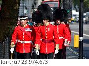 Купить «London, England, UK. Members of the Coldstream Guards marching down Whitehall.», фото № 23974673, снято 15 сентября 2016 г. (c) age Fotostock / Фотобанк Лори