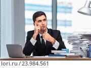Купить «Young businessman working in the office», фото № 23984561, снято 28 июня 2016 г. (c) Elnur / Фотобанк Лори