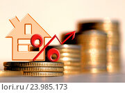 Купить «Красный знак процента на фоне денег», фото № 23985173, снято 3 мая 2016 г. (c) Сергеев Валерий / Фотобанк Лори