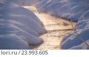 Купить «Пар в солнечных лучах над ручьем зимой / Vapor over small creek in winter under Sun rays», видеоролик № 23993605, снято 29 октября 2016 г. (c) Serg Zastavkin / Фотобанк Лори