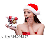 Купить «Young santa girl in christmas concept isolated on white», фото № 24044857, снято 29 сентября 2016 г. (c) Elnur / Фотобанк Лори