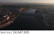 Купить «Aerial view of the old part of Prague and bridges over the Vltava river at sunrise. Charles bridge. Urban landscape», видеоролик № 24047905, снято 22 сентября 2016 г. (c) Данил Руденко / Фотобанк Лори