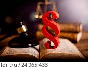 Купить «Paragraph, law theme, mallet of judge, wooden gavel», фото № 24065433, снято 1 августа 2014 г. (c) easy Fotostock / Фотобанк Лори