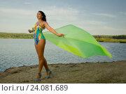 Купить «Beautiful adult woman in bikini and with pareo on the beach by the lake», фото № 24081689, снято 24 августа 2016 г. (c) Дмитрий Черевко / Фотобанк Лори