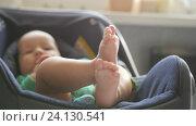 Купить «Close up of playful baby legs. Cute child bare heels. Handheld shot», видеоролик № 24130541, снято 9 октября 2016 г. (c) Павел Котельников / Фотобанк Лори