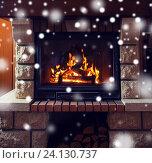 Купить «close up of burning fireplace with snow», фото № 24130737, снято 16 октября 2015 г. (c) Syda Productions / Фотобанк Лори