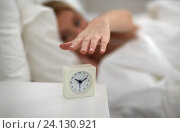 Купить «close up of woman with alarm clock in bed at home», фото № 24130921, снято 30 апреля 2016 г. (c) Syda Productions / Фотобанк Лори