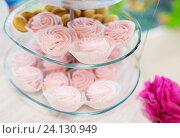 Купить «close up of custard sweets on glass serving tray», фото № 24130949, снято 11 июня 2016 г. (c) Syda Productions / Фотобанк Лори