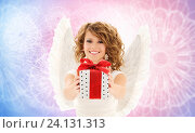 happy woman with angel wings and birthday gift. Стоковое фото, фотограф Syda Productions / Фотобанк Лори