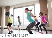 Купить «group of people exercising with barbell in gym», фото № 24131397, снято 5 апреля 2015 г. (c) Syda Productions / Фотобанк Лори