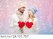 Купить «smiling couple in winter clothes with red hearts», фото № 24131757, снято 8 октября 2015 г. (c) Syda Productions / Фотобанк Лори