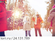 Купить «happy friends playing snowball in winter forest», фото № 24131789, снято 29 декабря 2014 г. (c) Syda Productions / Фотобанк Лори
