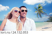 Купить «couple in shades over tropical beach background», фото № 24132053, снято 14 июля 2013 г. (c) Syda Productions / Фотобанк Лори