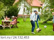 Купить «friends playing football with dog at summer garden», фото № 24132453, снято 28 августа 2016 г. (c) Syda Productions / Фотобанк Лори