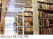 Купить «bookshelves with books at school library», фото № 24132745, снято 18 февраля 2015 г. (c) Syda Productions / Фотобанк Лори