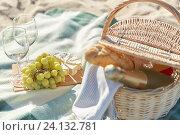 Купить «picnic basket with wine glasses and food on beach», фото № 24132781, снято 18 августа 2015 г. (c) Syda Productions / Фотобанк Лори