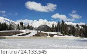 Купить «Зимняя дорога с тоннелями в снежных горах, горнолыжный курорт Красная Поляна», фото № 24133545, снято 1 апреля 2016 г. (c) DiS / Фотобанк Лори