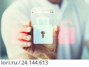 Купить «close up of hand with security lock on smartphone», фото № 24144613, снято 13 августа 2015 г. (c) Syda Productions / Фотобанк Лори