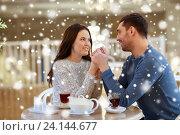 Купить «happy couple with tea holding hands at restaurant», фото № 24144677, снято 23 января 2016 г. (c) Syda Productions / Фотобанк Лори
