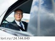 Купить «senior businessman driving on car back seat», фото № 24144849, снято 16 июля 2016 г. (c) Syda Productions / Фотобанк Лори