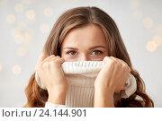 Купить «young woman or teen girl pulling pullover collar», фото № 24144901, снято 15 октября 2016 г. (c) Syda Productions / Фотобанк Лори