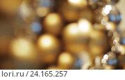 Купить «golden christmas decoration or garland of beads», видеоролик № 24165257, снято 3 ноября 2016 г. (c) Syda Productions / Фотобанк Лори
