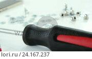 Купить «Close-up of screwdriver and screws», видеоролик № 24167237, снято 16 октября 2019 г. (c) Wavebreak Media / Фотобанк Лори