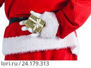 Купить «Santa clause holding a gift box behind his back», фото № 24179313, снято 6 сентября 2016 г. (c) Wavebreak Media / Фотобанк Лори