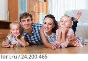 Купить «portrait of happy parents with girls», фото № 24200465, снято 24 сентября 2018 г. (c) Яков Филимонов / Фотобанк Лори