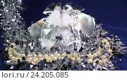 Купить «Новогодние шары и ленты на синем фоне», видеоролик № 24205085, снято 12 ноября 2009 г. (c) Куликов Константин / Фотобанк Лори