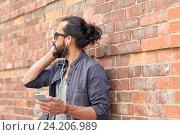 man with earphones and smartphone on street, фото № 24206989, снято 2 июня 2016 г. (c) Syda Productions / Фотобанк Лори