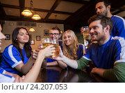 Купить «football fans clinking beer glasses at sport bar», фото № 24207053, снято 14 июля 2016 г. (c) Syda Productions / Фотобанк Лори